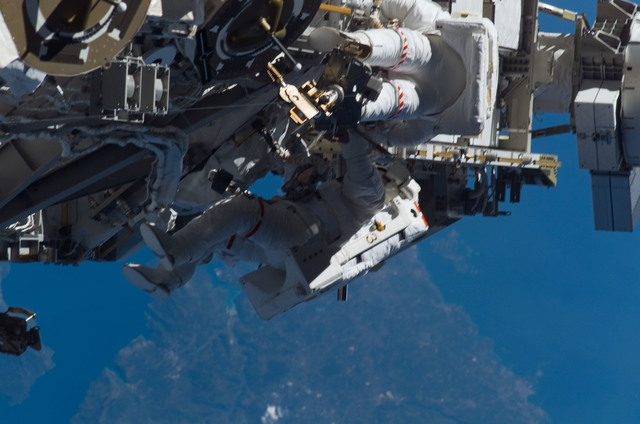S115E05981 - STS-115 - STS-115 MS Burbank and MacLean prepare the SARJ on the P3 - P4 Truss Segment during EVA
