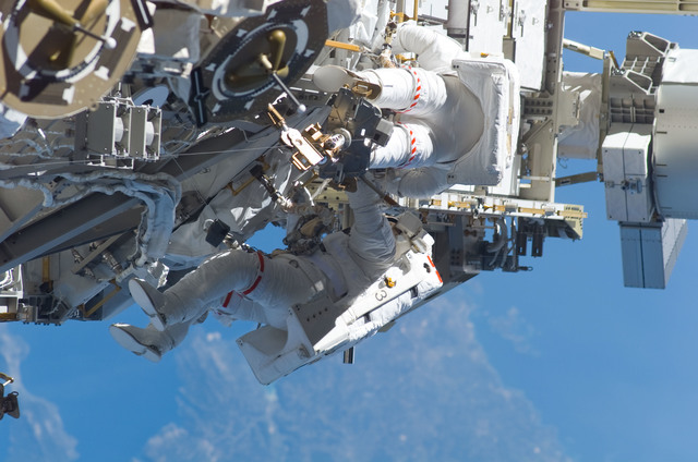 S115E05982 - STS-115 - STS-115 MS Burbank and MacLean prepare the SARJ on the P3 - P4 Truss Segment during EVA
