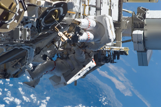 S115E05983 - STS-115 - STS-115 MS Burbank and MacLean prepare the SARJ on the P3 - P4 Truss Segment during EVA