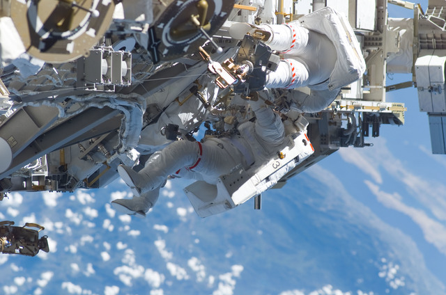 S115E05985 - STS-115 - STS-115 MS Burbank and MacLean prepare the SARJ on the P3 - P4 Truss Segment during EVA