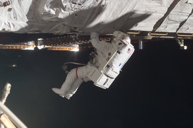S115E06135 - STS-115 - STS-115 MS Tanner working on the P3/P4 Truss during EVA