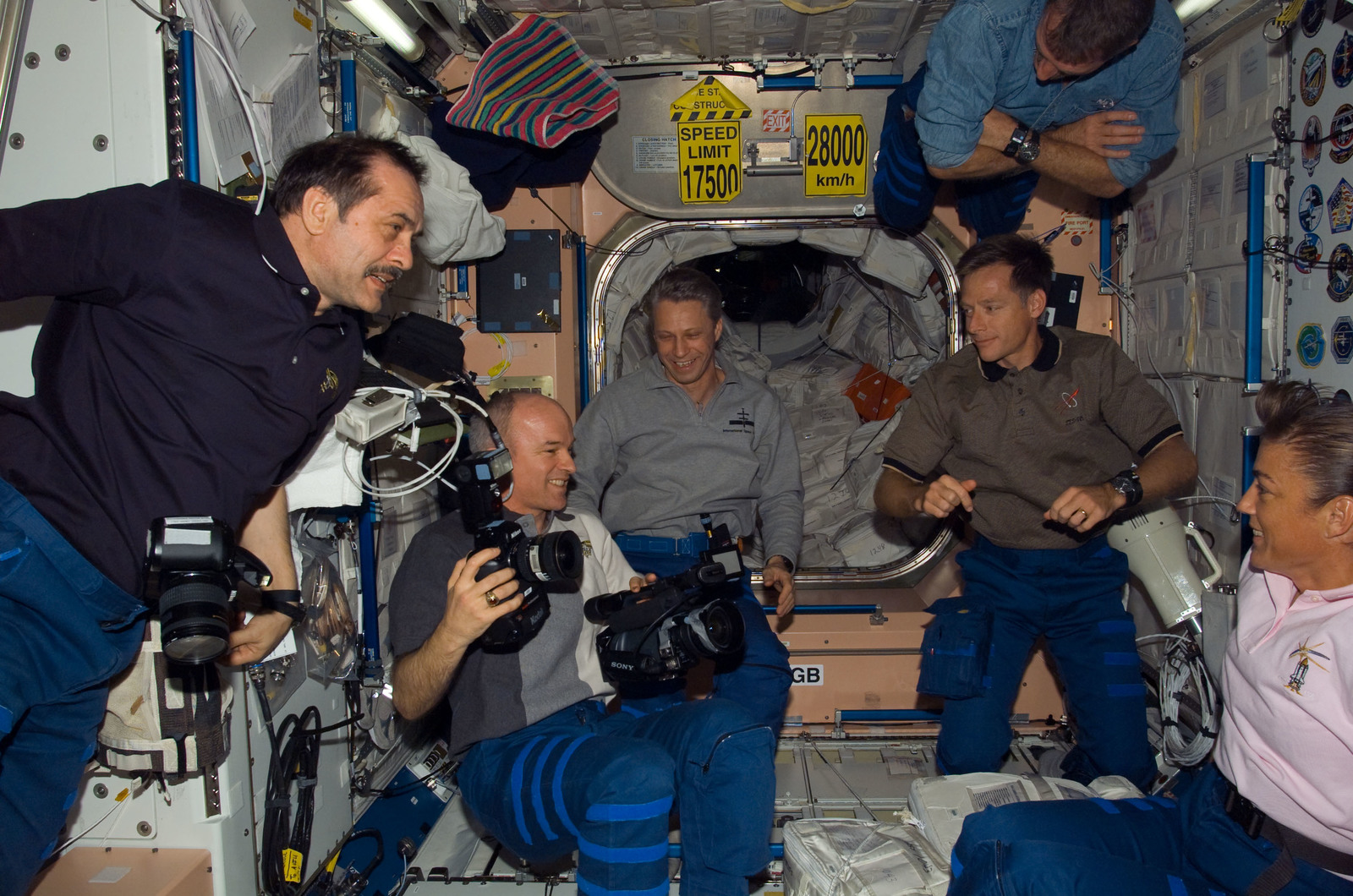 S115E06523 - STS-115 - STS-115 and Expedition 13 crewmembers in the Node 1 during Joint Operations