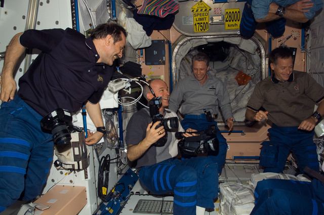 S115E06524 - STS-115 - STS-115 and Expedition 13 crewmembers in the Node 1 during Joint Operations