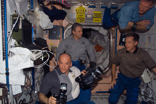 S115E06600 - STS-115 - STS-115 and Expedition 13 crewmembers in the Node 1 during Joint Operations