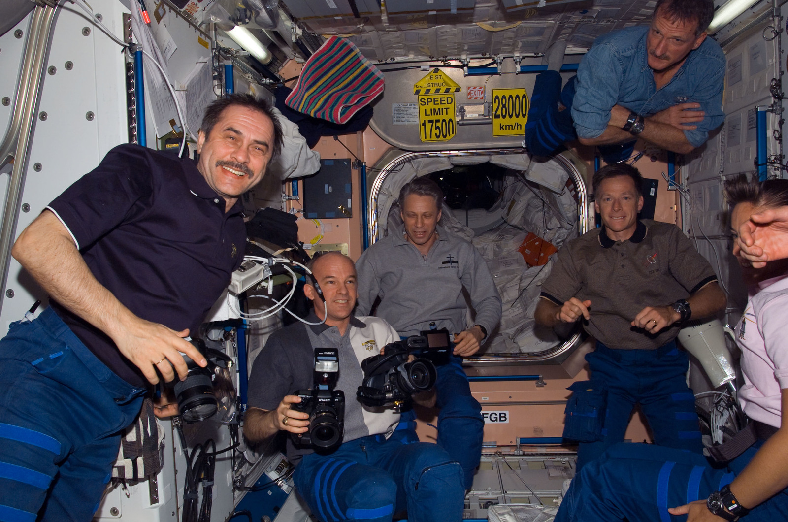 S115E06602 - STS-115 - STS-115 and Expedition 13 crewmembers in the Node 1 during Joint Operations