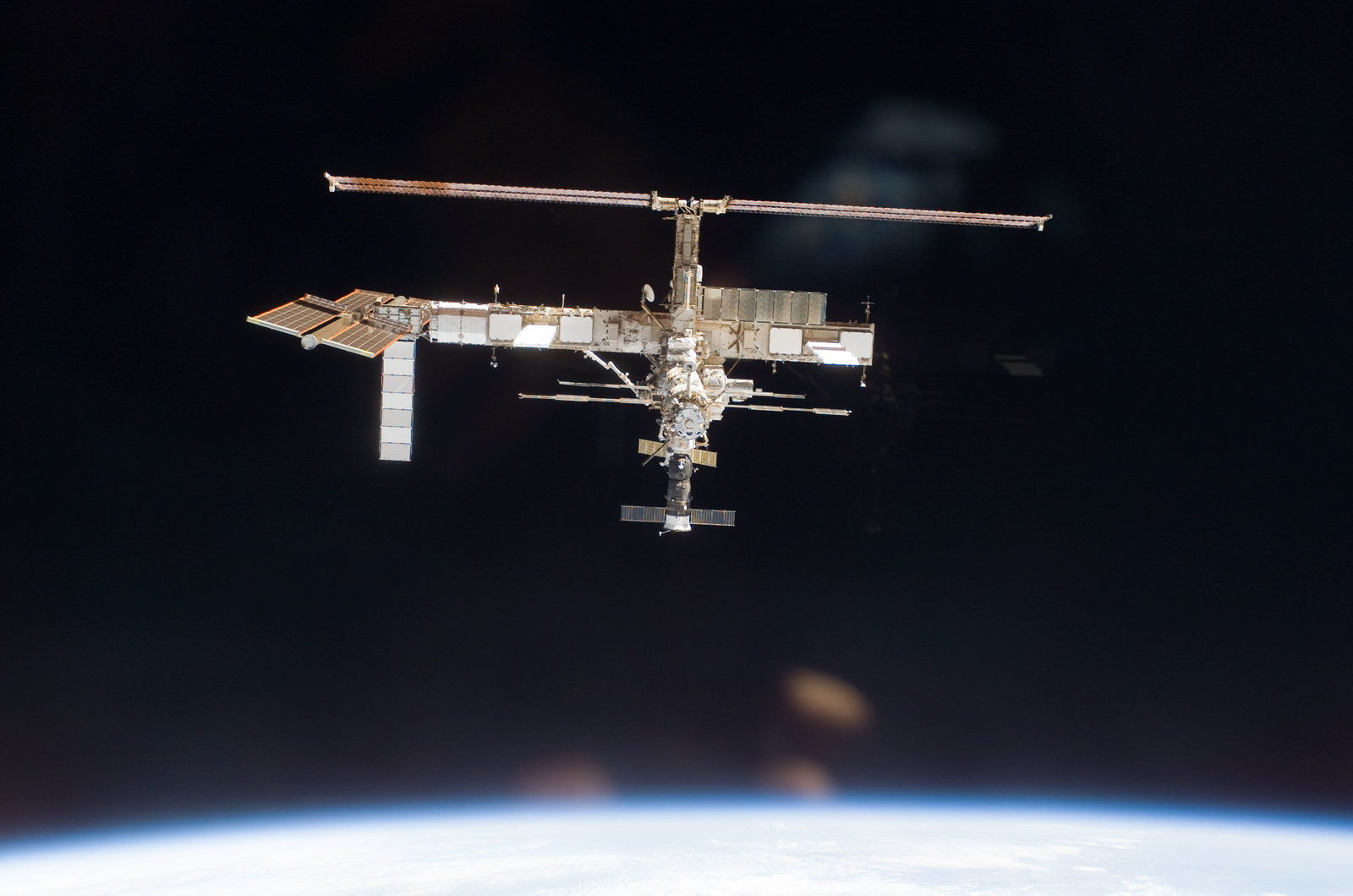 S115E06698 - STS-115 - Overall exterior view of the ISS during undocking and Flyaround Operations for STS-115 Space Shuttle Atlantis