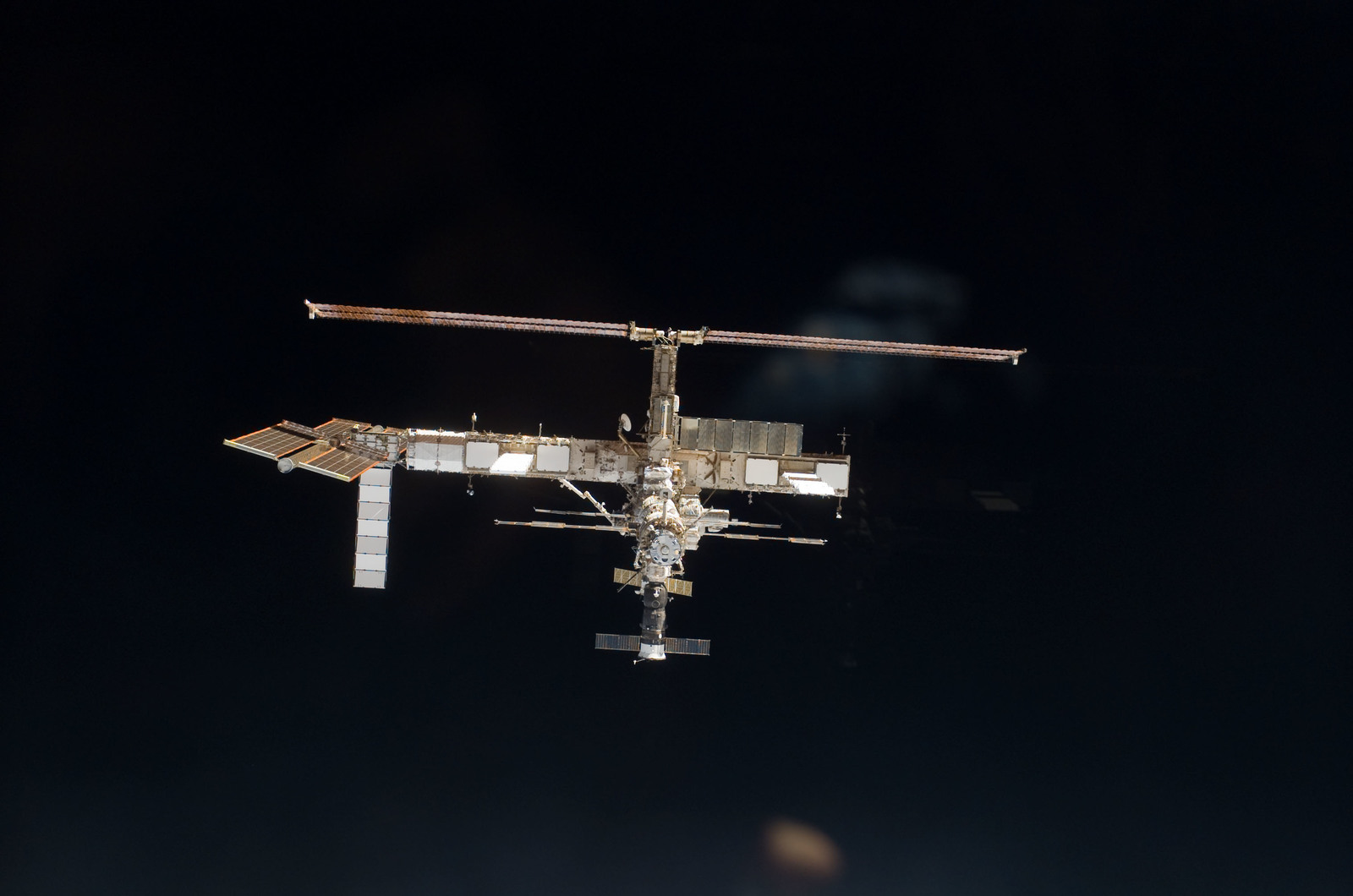 S115E06699 - STS-115 - Overall exterior view of the ISS during undocking and Flyaround Operations for STS-115 Space Shuttle Atlantis