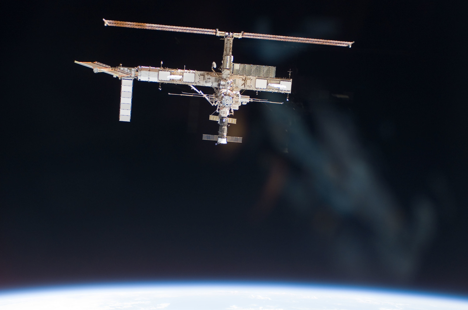 S115E06701 - STS-115 - Overall exterior view of the ISS during undocking and Flyaround Operations for STS-115 Space Shuttle Atlantis