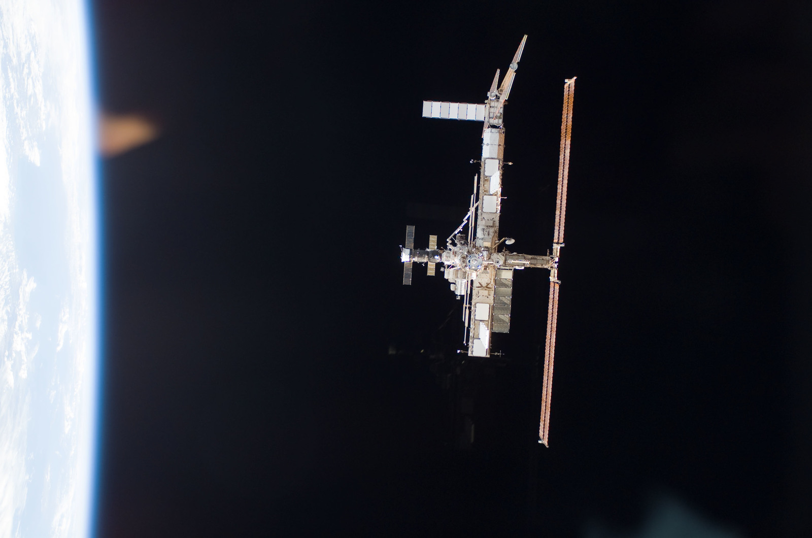 S115E06702 - STS-115 - Overall exterior view of the ISS during undocking and Flyaround Operations for STS-115 Space Shuttle Atlantis