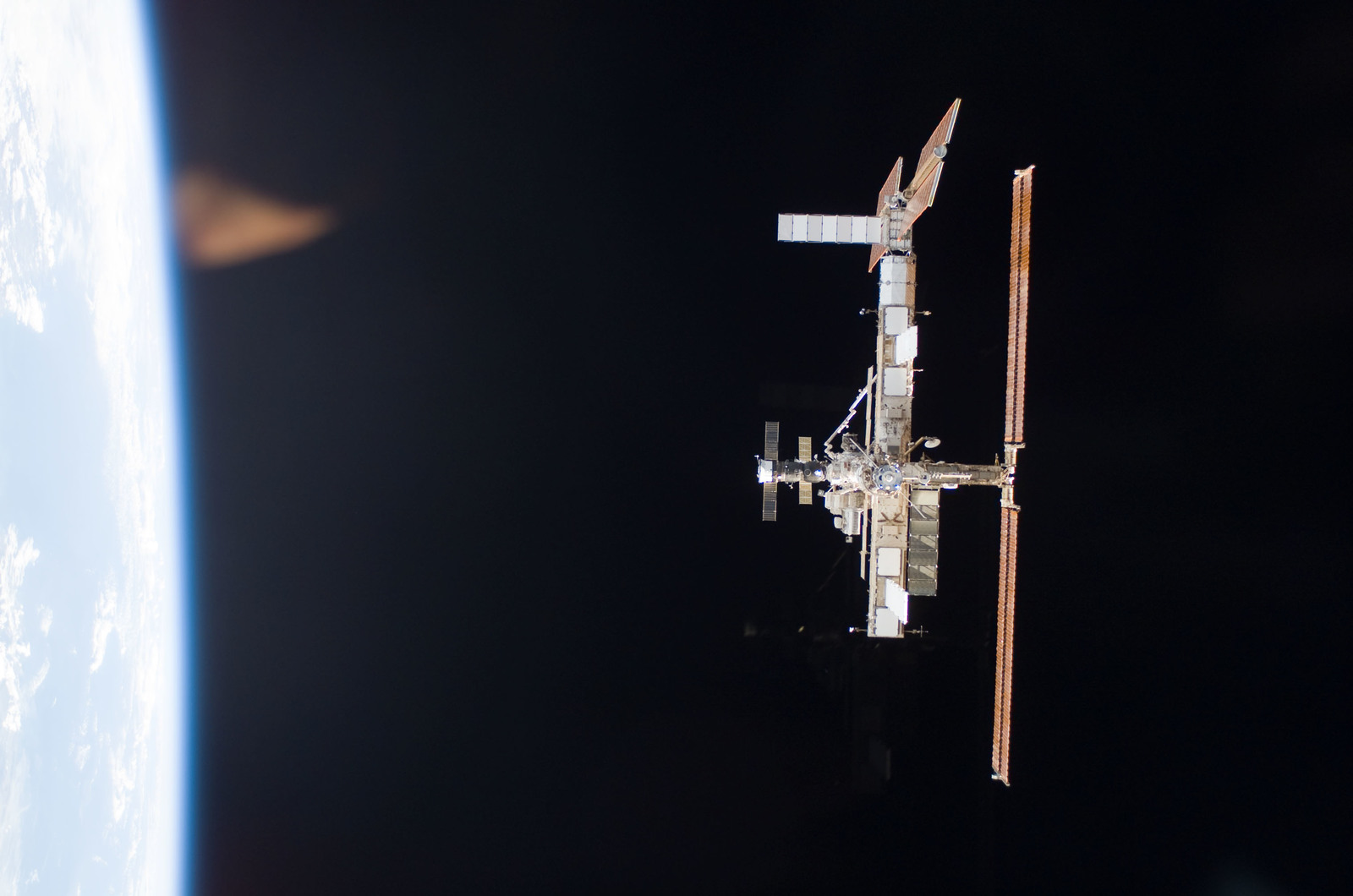 S115E06703 - STS-115 - Overall exterior view of the ISS during undocking and Flyaround Operations for STS-115 Space Shuttle Atlantis