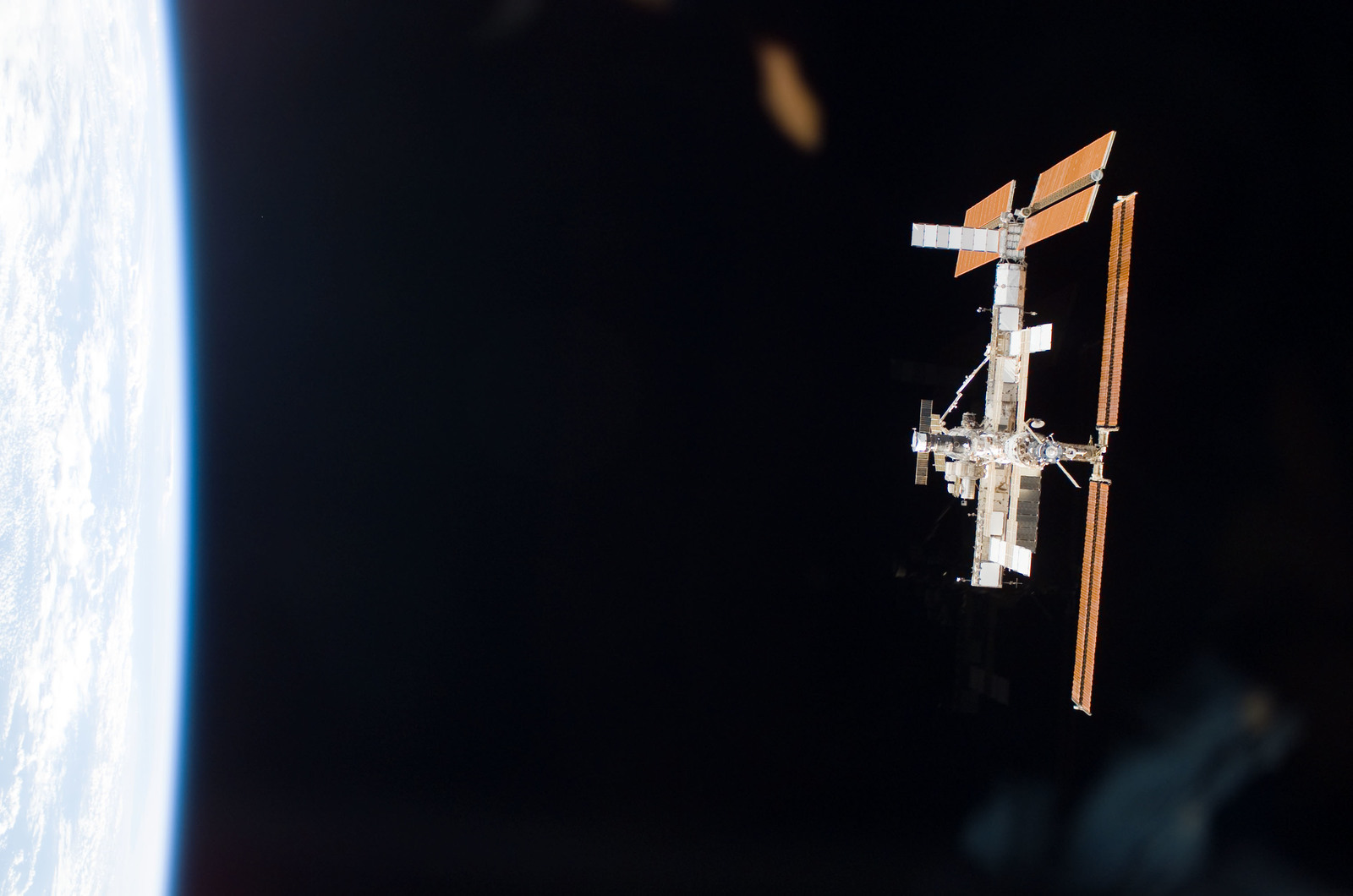 S115E06706 - STS-115 - Overall exterior view of the ISS during undocking and Flyaround Operations for STS-115 Space Shuttle Atlantis