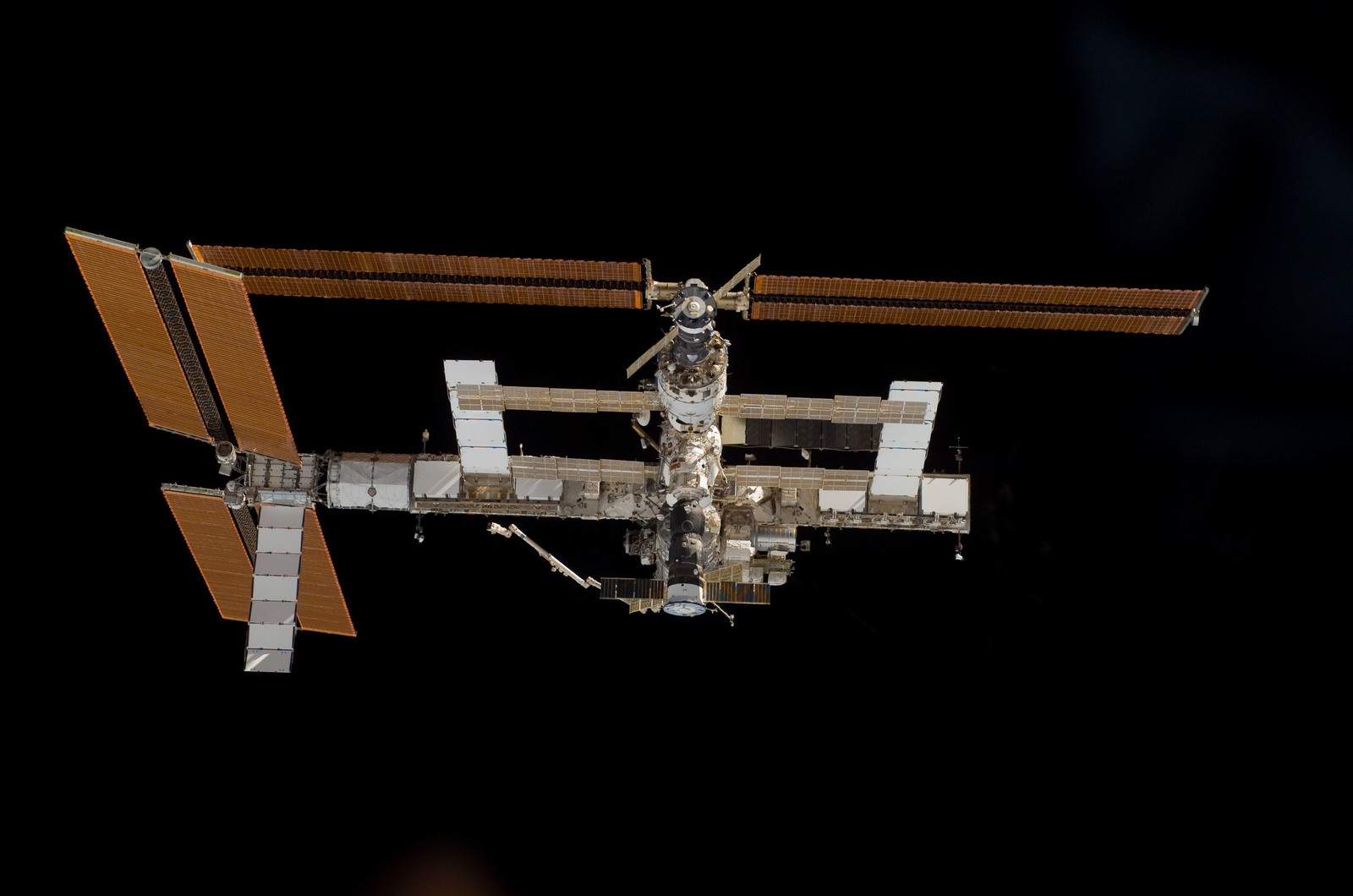 S115E06709 - STS-115 - Overall exterior view of the ISS during undocking and Flyaround Operations for STS-115 Space Shuttle Atlantis