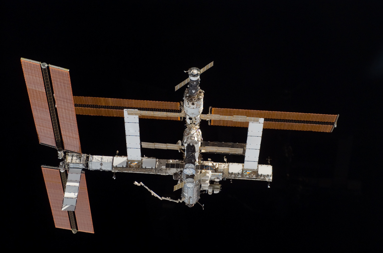 S115E06712 - STS-115 - Overall exterior view of the ISS during undocking and Flyaround Operations for STS-115 Space Shuttle Atlantis