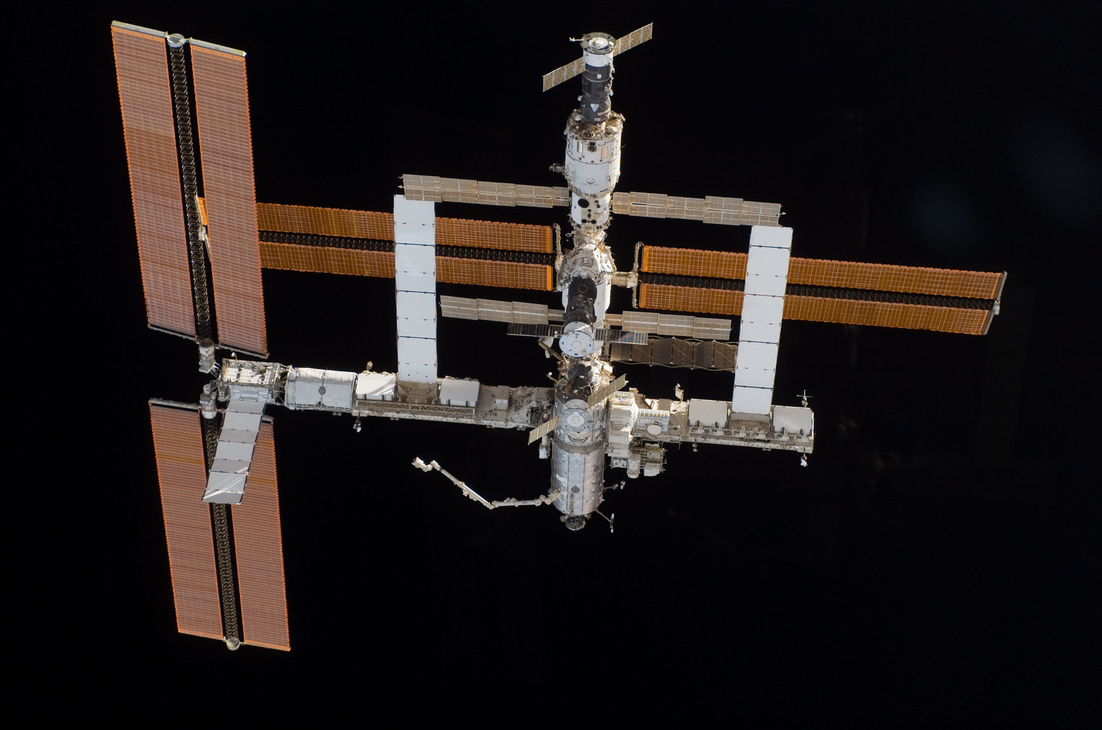 S115E06715 - STS-115 - Overall exterior view of the ISS during undocking and Flyaround Operations for STS-115 Space Shuttle Atlantis