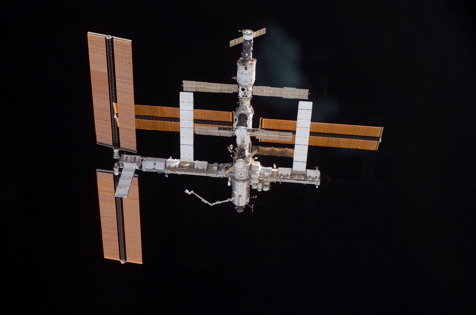 S115E06716 - STS-115 - Overall exterior view of the ISS during undocking and Flyaround Operations for STS-115 Space Shuttle Atlantis