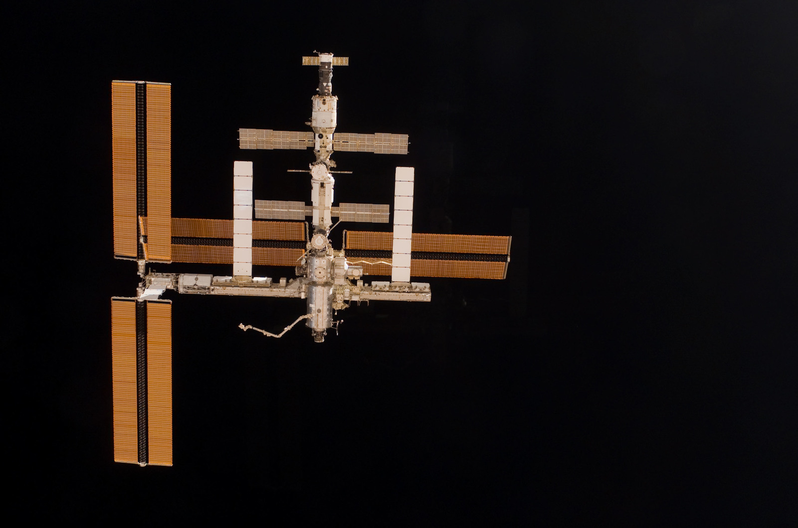 S115E06722 - STS-115 - Overall exterior view of the ISS during undocking and Flyaround Operations for STS-115 Space Shuttle Atlantis