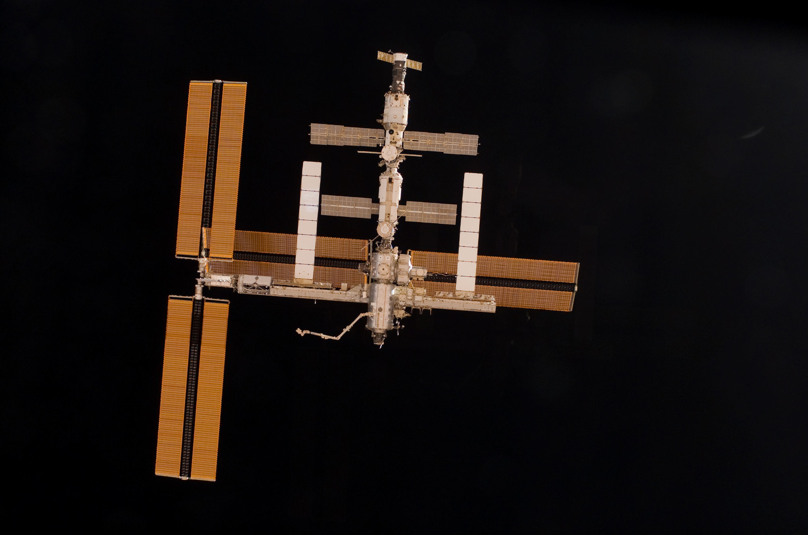 S115E06725 - STS-115 - Overall exterior view of the ISS during undocking and Flyaround Operations for STS-115 Space Shuttle Atlantis
