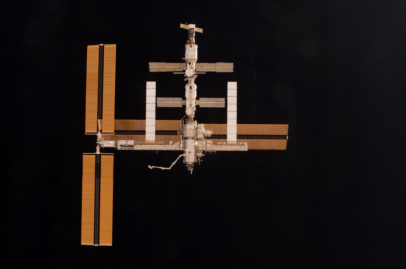 S115E06726 - STS-115 - Overall exterior view of the ISS during undocking and Flyaround Operations for STS-115 Space Shuttle Atlantis