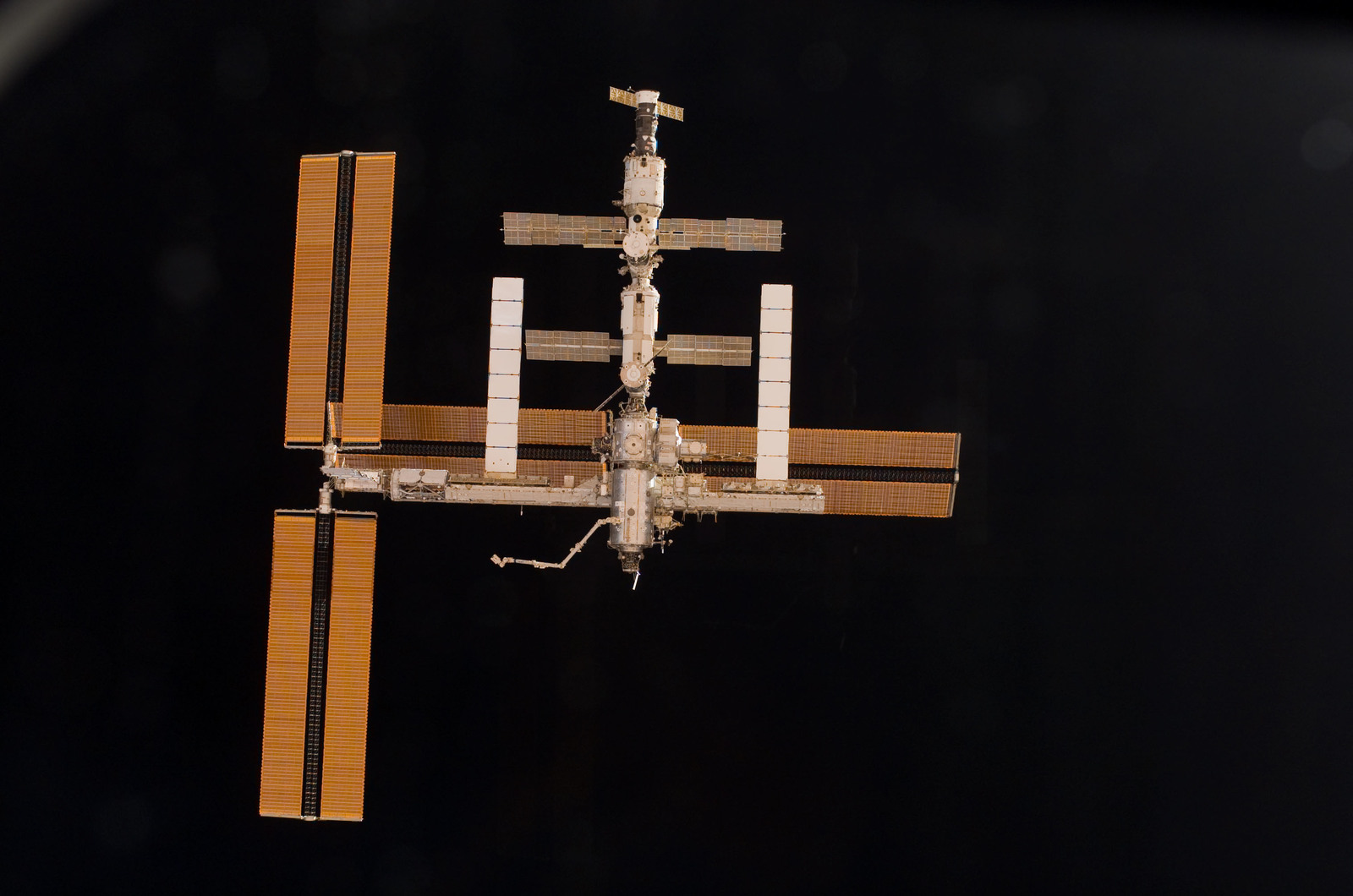 S115E06727 - STS-115 - Overall exterior view of the ISS during undocking and Flyaround Operations for STS-115 Space Shuttle Atlantis