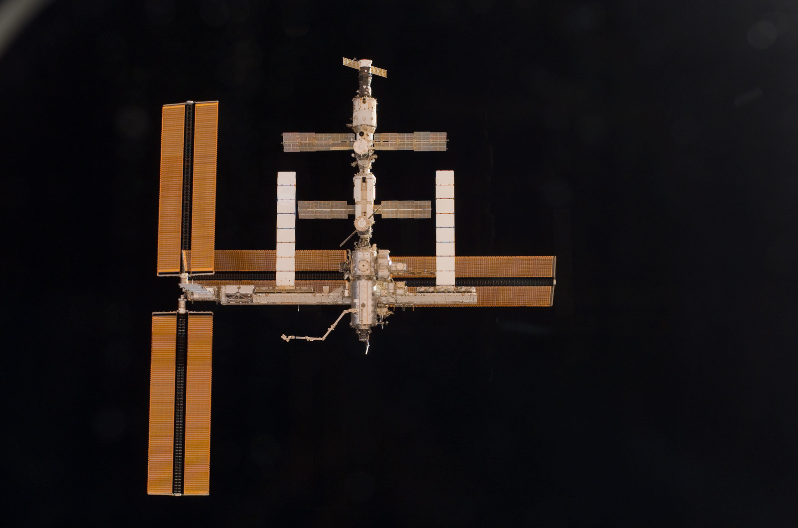 S115E06728 - STS-115 - Overall exterior view of the ISS during undocking and Flyaround Operations for STS-115 Space Shuttle Atlantis