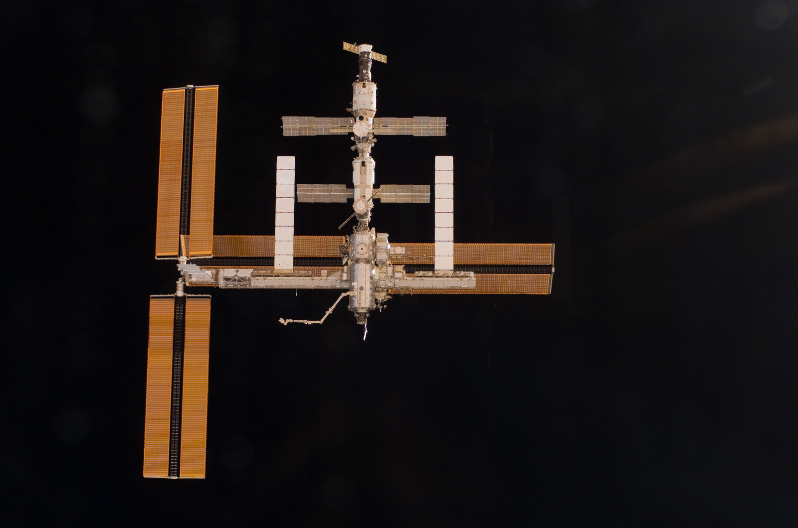 S115E06729 - STS-115 - Overall exterior view of the ISS during undocking and Flyaround Operations for STS-115 Space Shuttle Atlantis