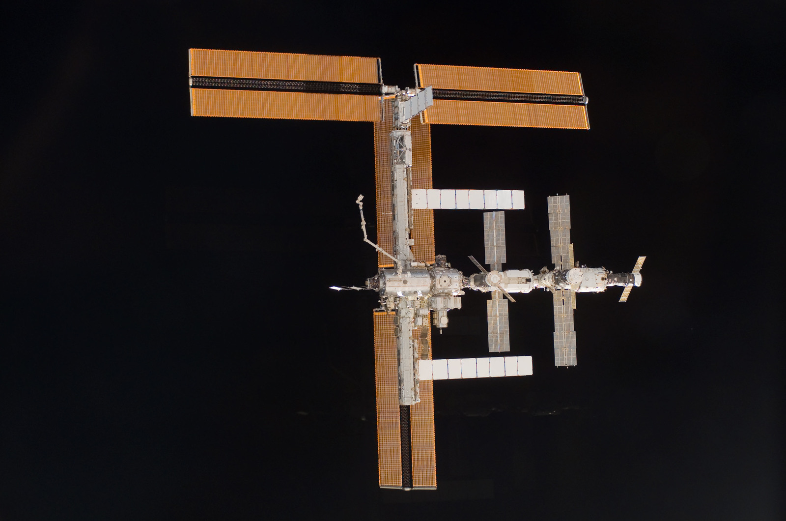 S115E06734 - STS-115 - Overall exterior view of the ISS during undocking and Flyaround Operations for STS-115 Space Shuttle Atlantis