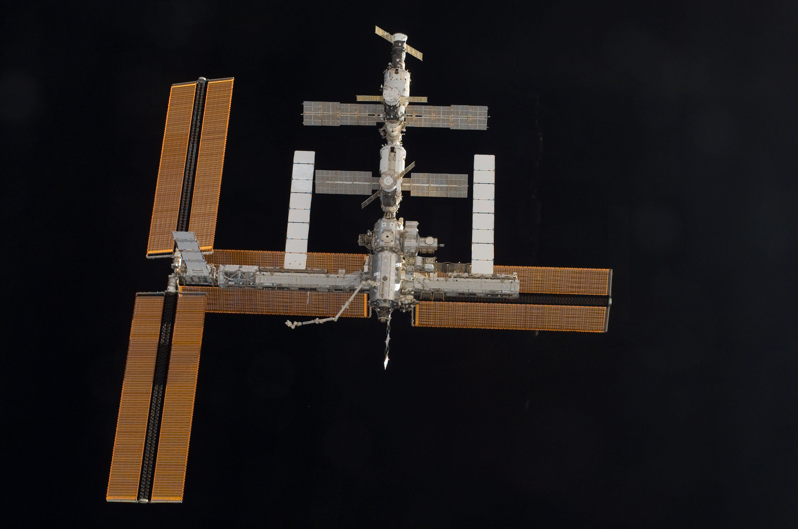 S115E06735 - STS-115 - Overall exterior view of the ISS during undocking and Flyaround Operations for STS-115 Space Shuttle Atlantis