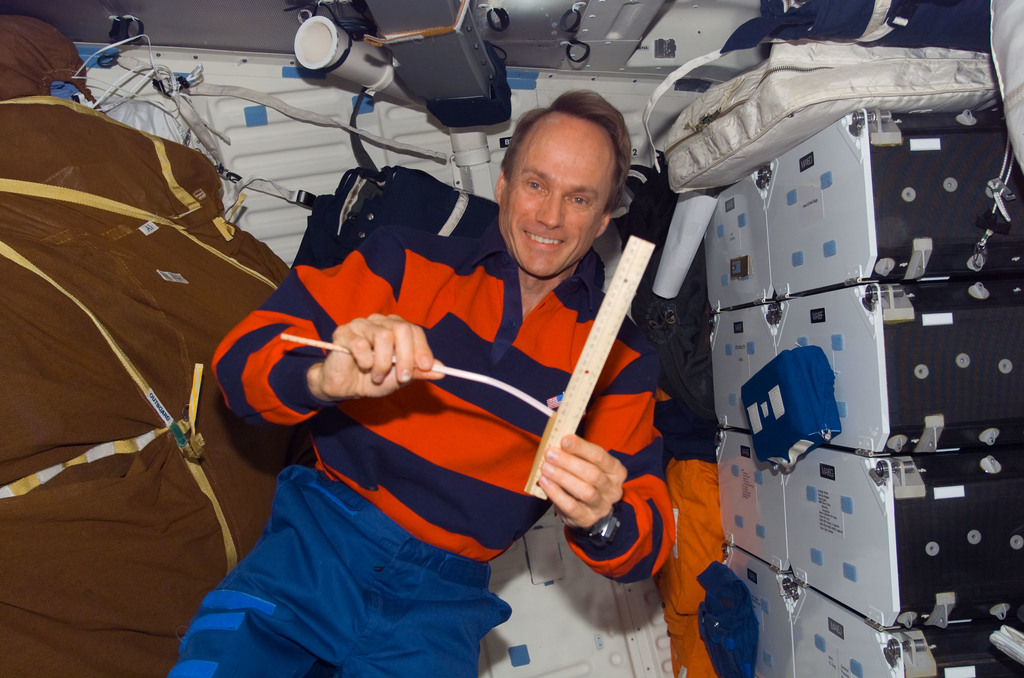 S115E07209 - STS-115 - STS-115 MacLean holds measuring instrument in the aft MDDK during Joint Operations