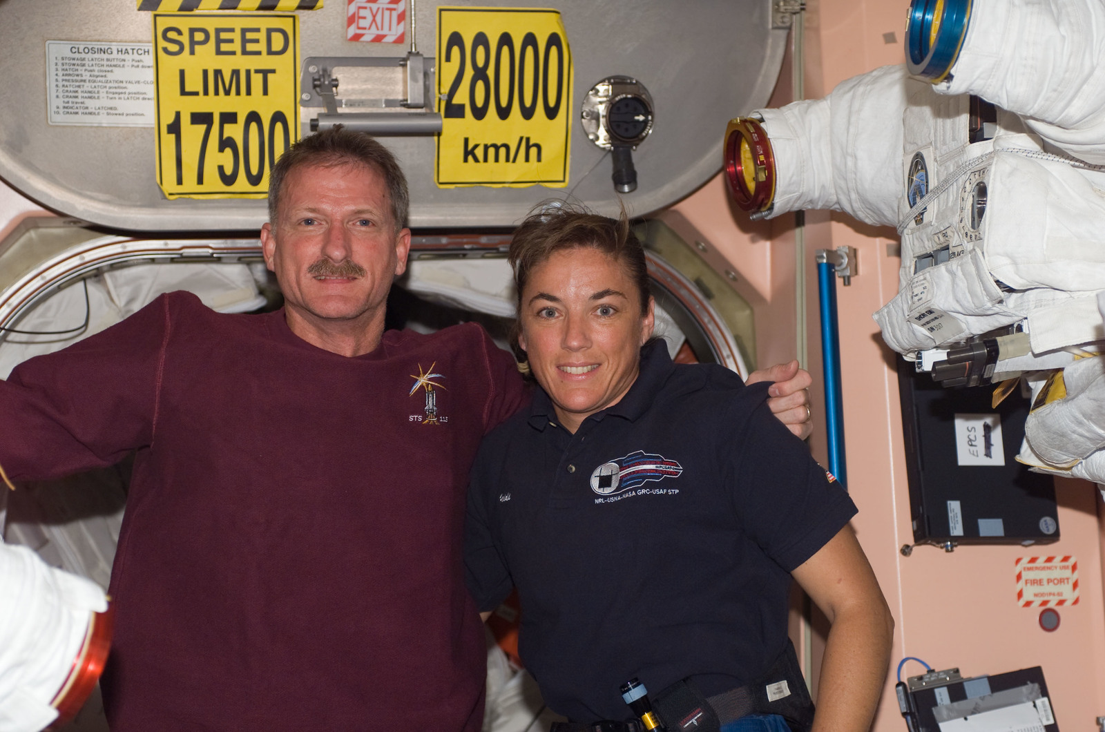 S115E07385 - STS-115 - STS-115 MS Tanner and Stefanyshyn-Piper pose at the Node 1 hatch area during Joint Operations