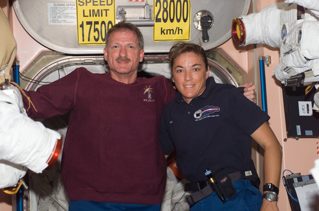 S115E07386 - STS-115 - STS-115 MS Tanner and Stefanyshyn-Piper pose at the Node 1 hatch area during Joint Operations