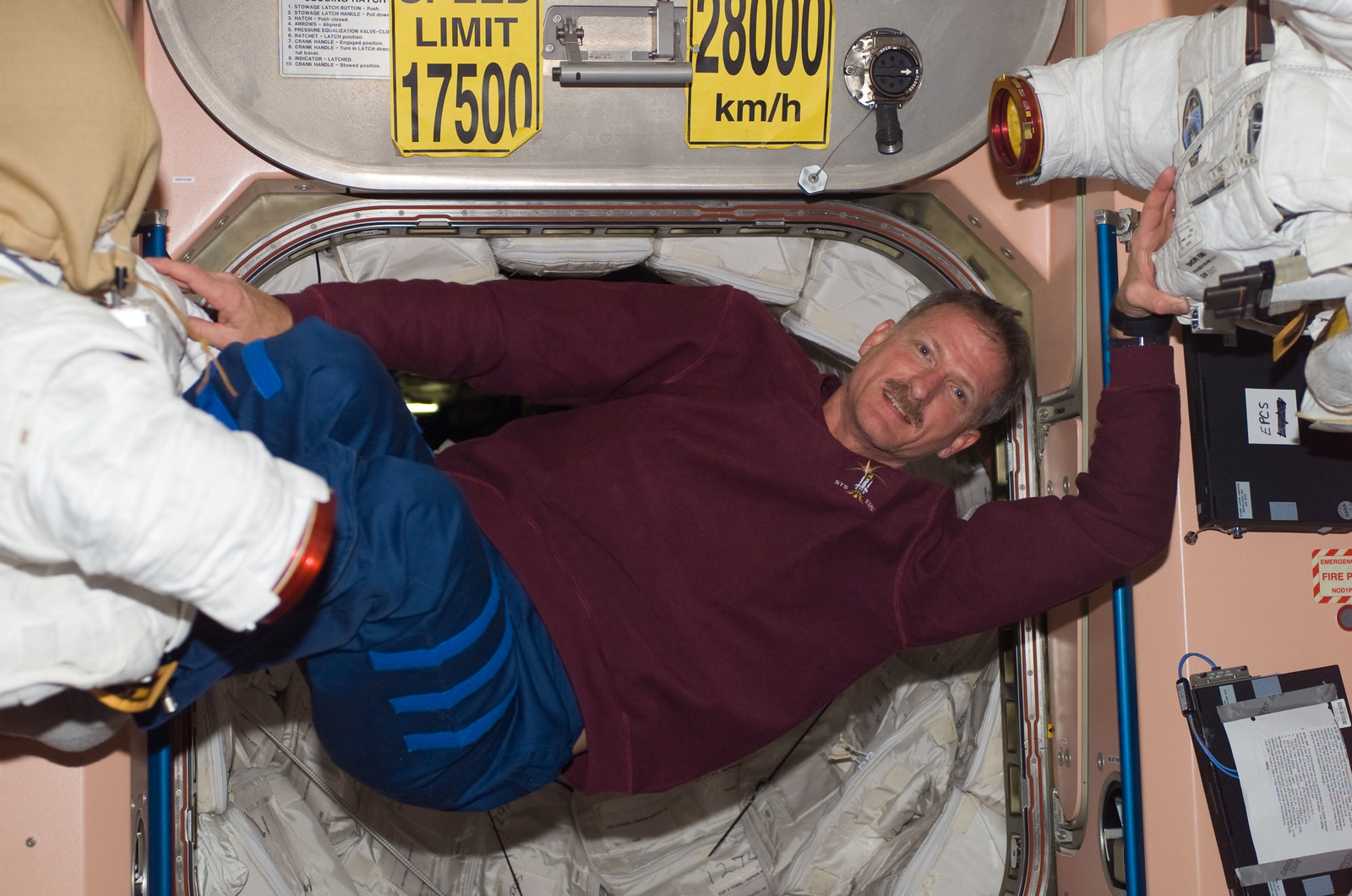 S115E07389 - STS-115 - STS-115 Tanner floats in the Node 1 hatch area during Expedition 13 / STS-115 Joint Operations