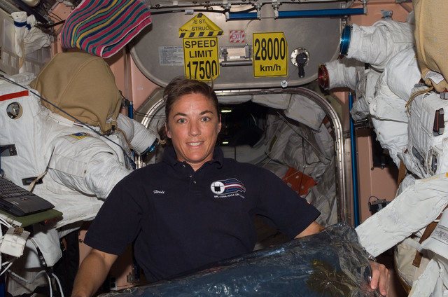 S115E07392 - STS-115 - STS-115 Stefanyshn-Piper poses in the Node 1 during Expedition 13 / STS-115 Joint Operations