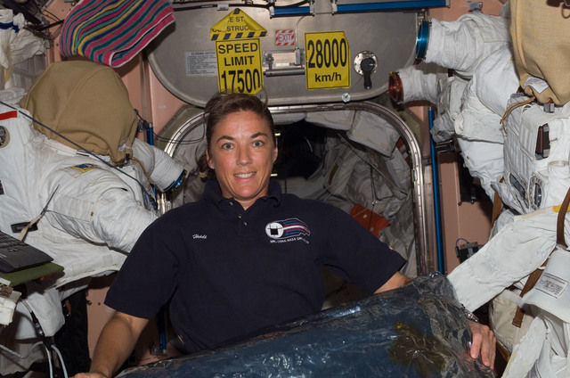 S115E07393 - STS-115 - STS-115 Stefanyshn-Piper poses in the Node 1 during Expedition 13 / STS-115 Joint Operations