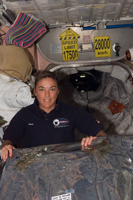 S115E07394 - STS-115 - STS-115 Stefanyshn-Piper poses in the Node 1 during Expedition 13 / STS-115 Joint Operations