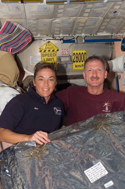S115E07398 - STS-115 - STS-115 Stefanyshyn-Piper and Tanner pose in the Node 1 during Expedition 13 / STS-115 Joint Operations