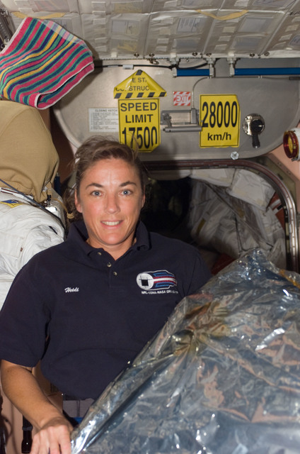 S115E07400 - STS-115 - STS-115 Stefanyshyn-Piper pose in the Node 1 during Expedition 13 / STS-115 Joint Operations