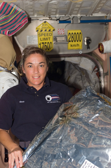 S115E07401 - STS-115 - STS-115 Stefanyshyn-Piper pose in the Node 1 during Expedition 13 / STS-115 Joint Operations