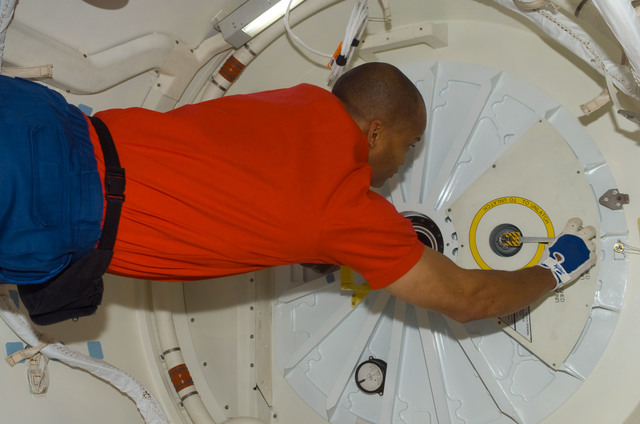 S116E05569 - STS-116 - STS-116 MS Curbeam,Jr., prepares to open hatch on Space Shuttle Discovey