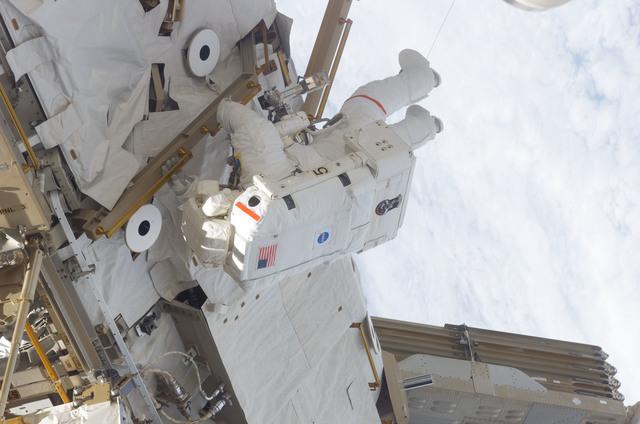 S116E06570 - STS-116 - STS-116 MS Curbeam, Jr., works on the S0 and S1 Truss during EVA 3