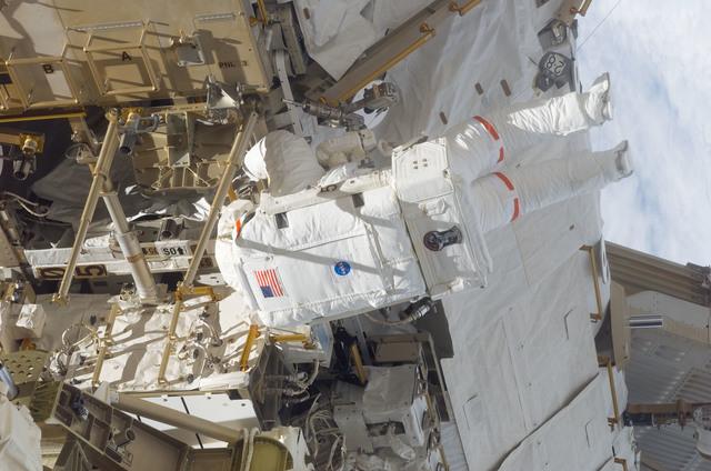 S116E06571 - STS-116 - STS-116 MS Curbeam,Jr.,works on the S0 and S1 Truss during EVA 3
