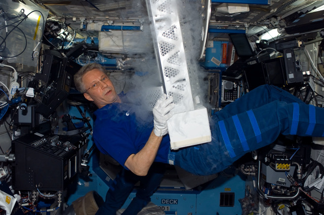 S116E07446 - STS-116 - Expedition 14 FE Reiter work on POEMS payload in the U.S. Laboratory during Joint Operations