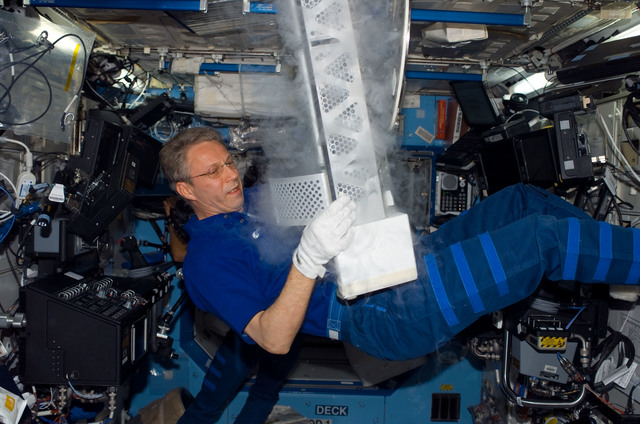 S116E07447 - STS-116 - Expedition 14 FE Reiter work on POEMS payload in the U.S. Laboratory during Joint Operations