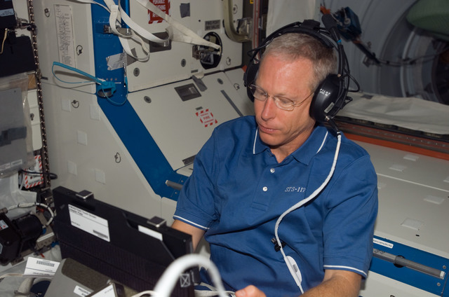 S117E07092 - STS-117 - Forrester works with the TRAC Experiment in the U.S Laboratory during Joint Operations