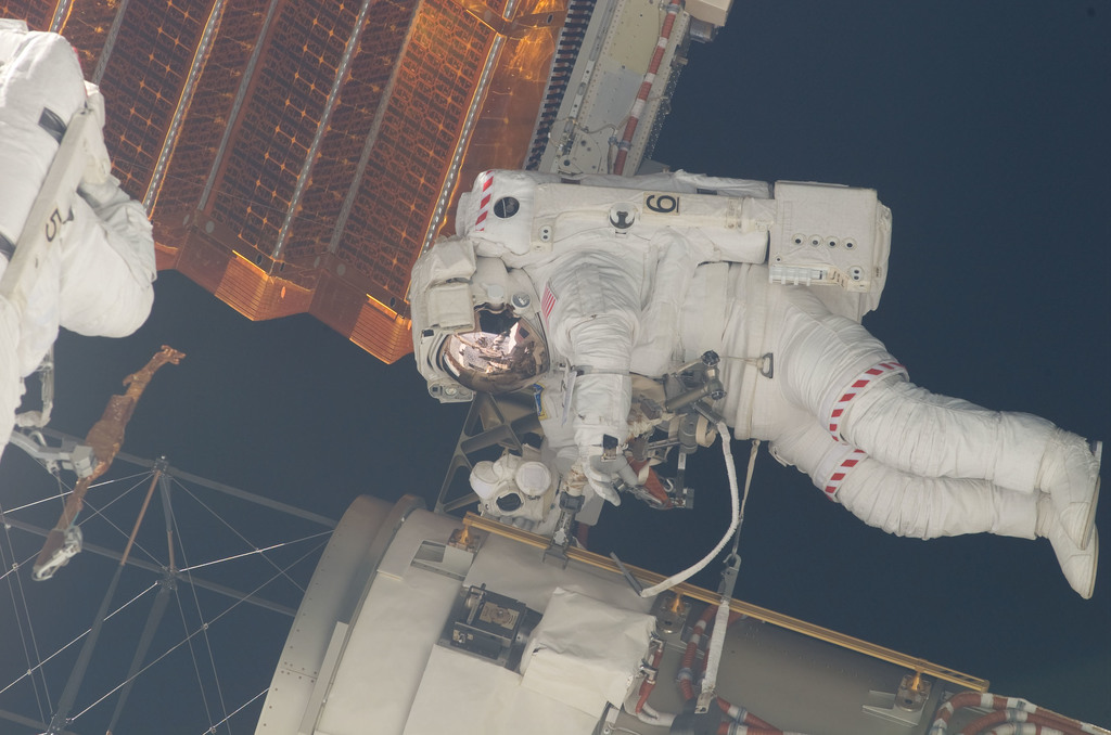 S117E07245 - STS-117 - Swanson and Forrester prepare to retract the P6 Truss STBD 2B SAW during EVA 2