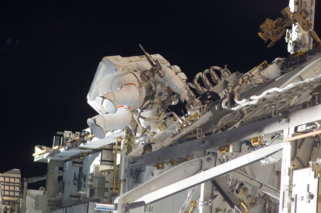S117E07282 - STS-117 - Forrester works at the S3/S4 Trusses during EVA 2 on STS-117 Mission