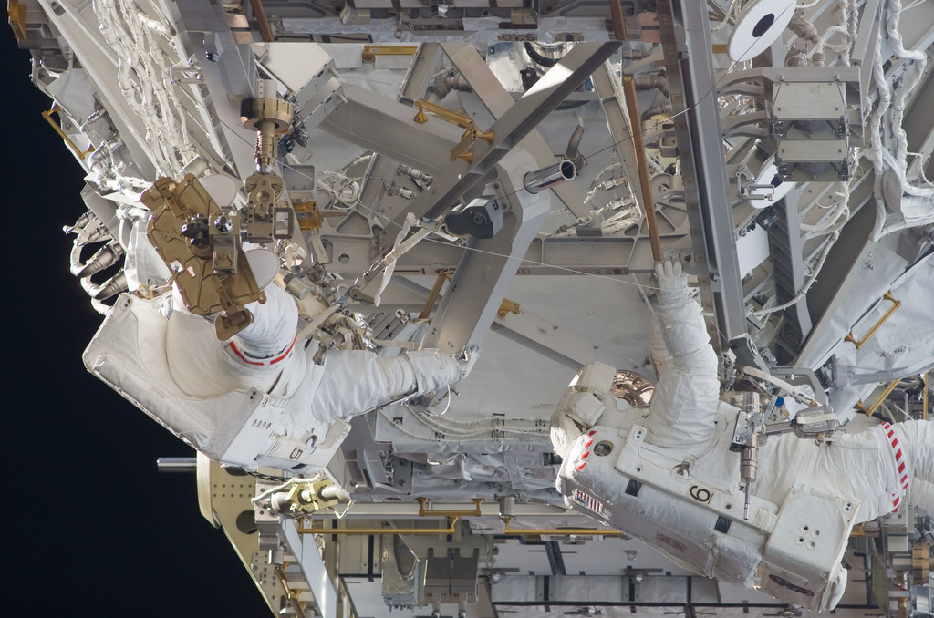 S117E07785 - STS-117 - Forrester and Swanson working on the S3 Truss during EVA 4