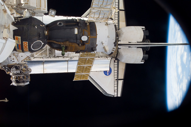 S118E09925 - STS-118 - View of docked Shuttle Endeavour and Soyuz TMA-10