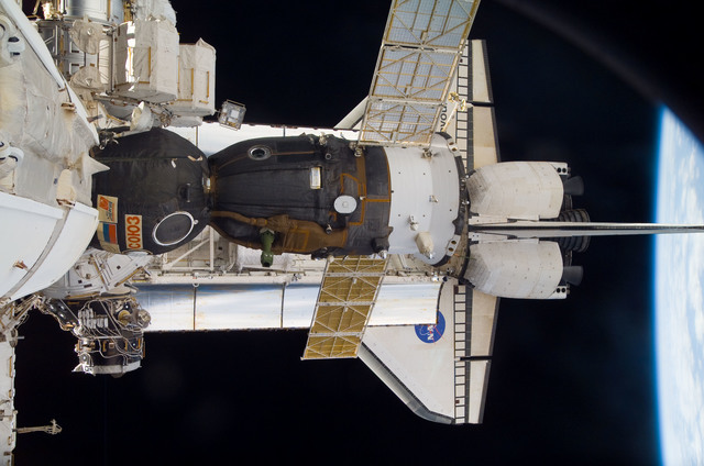 S118E09926 - STS-118 - View of docked Shuttle Endeavour and Soyuz TMA-10