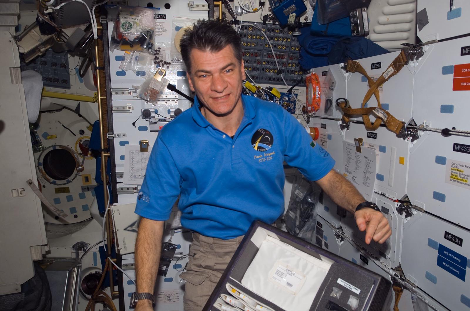 S120E008235 - STS-120 - Nespoli on middeck with locker