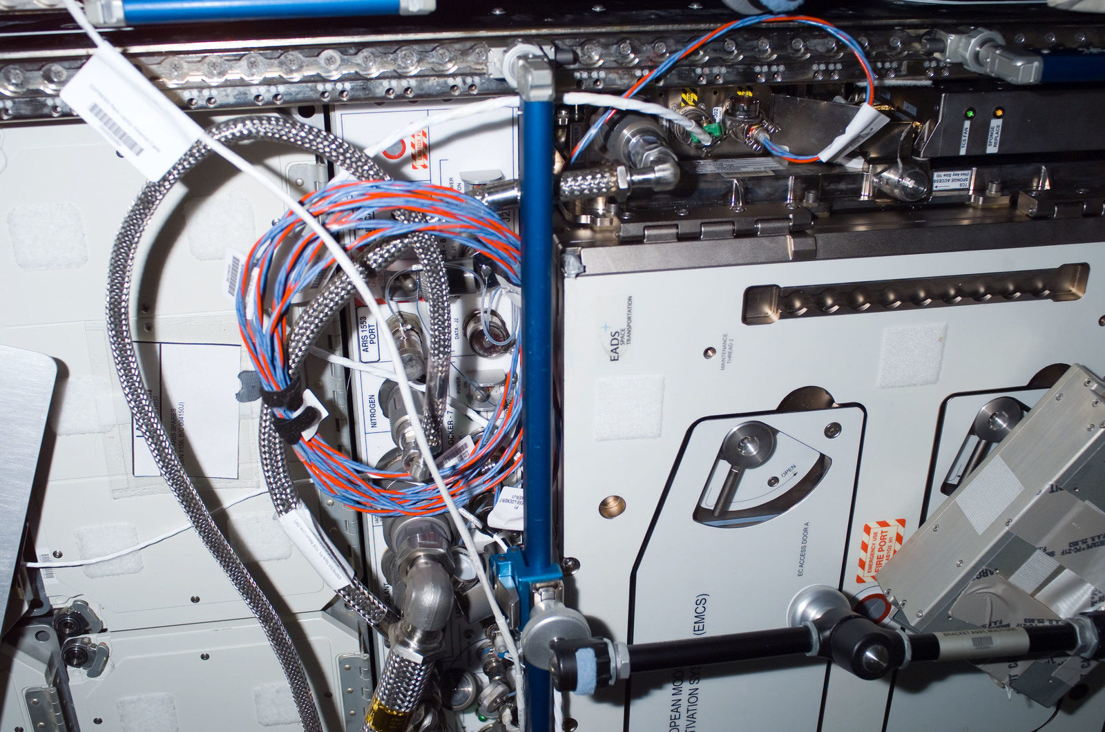 S120E008259 - STS-120 - Hoses on racks in Destiny module